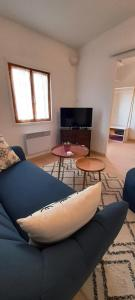 A television and/or entertainment centre at LOCABED - MARSEILLE CENTRE 2 PIECES 2 PERSONNES