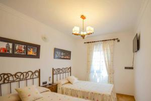 Säng eller sängar i ett rum på La Posada