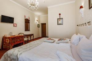 Кровать или кровати в номере Отель Бристоль