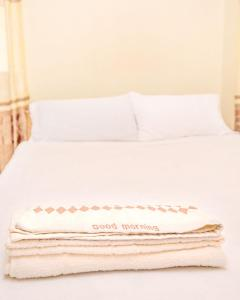 Ein Bett oder Betten in einem Zimmer der Unterkunft Camotes Eden