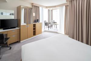 A bed or beds in a room at DoubleTree by Hilton Manchester Piccadilly