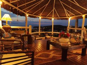 A restaurant or other place to eat at Bella Vista Ocean View