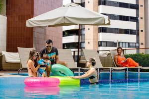 The swimming pool at or near San Marino Suite Hotel