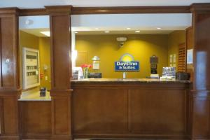 The lobby or reception area at Days Inn & Suites by Wyndham Omaha NE