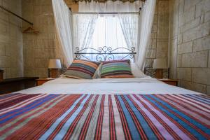 A bed or beds in a room at Vasiliou House