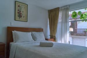 A bed or beds in a room at Hotel Fegali Art Boutique