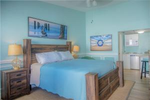 A bed or beds in a room at Sea and Breeze Hotel and Condo