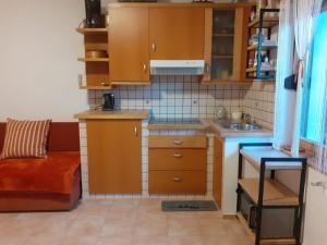 Kuchyňa alebo kuchynka v ubytovaní Apartment Norma