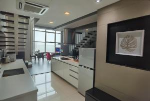 A kitchen or kitchenette at Home Hut @ 2BR Maritime Suite Jelutong Karpal Singh