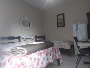 A bed or beds in a room at Pousada Encantus