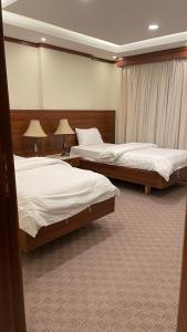 Cama ou camas em um quarto em الدور العالية- للوحدات السكنية
