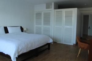 A bed or beds in a room at La Casa de Algodon