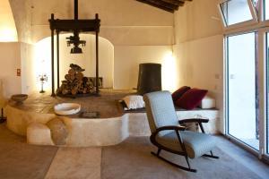Uma área de estar em Companhia das Culturas - Ecodesign & Spa Hotel