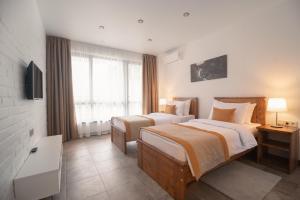 Кровать или кровати в номере Лес-Forest Apart Hotel