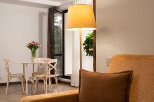 Гостиная зона в Лес-Forest Apart Hotel