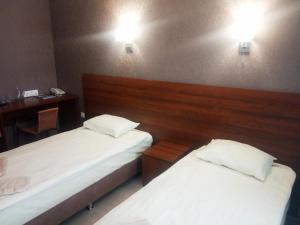 Кровать или кровати в номере Hotel Bosfor