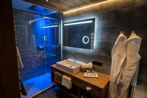 Ein Badezimmer in der Unterkunft Hotel Huber Hochland
