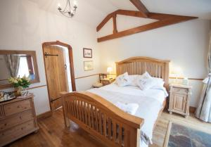 A bed or beds in a room at Beeches Farmhouse Rooms & Cottages
