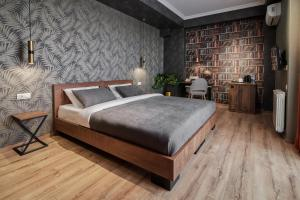 A bed or beds in a room at Hotel City