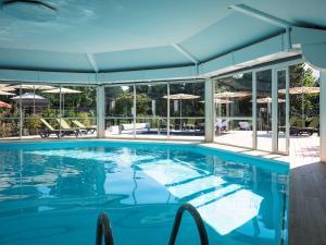 The swimming pool at or near Mercure Aix-les-Bains Domaine de Marlioz Hôtel & Spa