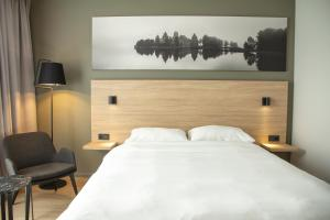 A bed or beds in a room at Park Inn by Radisson Vilnius Airport Hotel & Business Centre