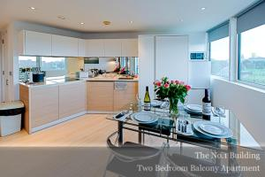 A kitchen or kitchenette at Gunwharf Quays Apartments