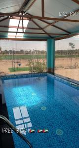 The swimming pool at or near Sweihan Inn Farm