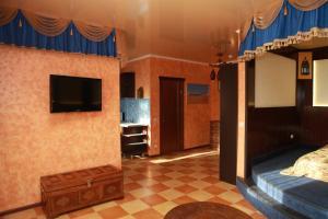 Телевизор и/или развлекательный центр в Апартаменты в Липецке