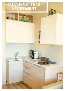 A kitchen or kitchenette at Residence Modus Vivendi