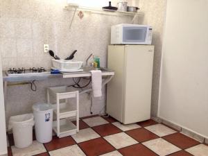 A kitchen or kitchenette at Apartamentos Hotel Avilla