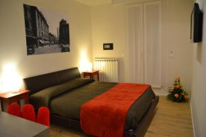 A bed or beds in a room at B&B Dell'Orso