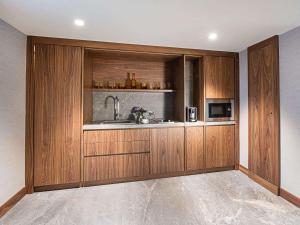 A kitchen or kitchenette at Rixos Sungate