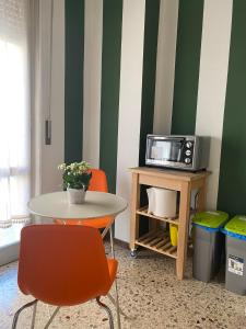 A television and/or entertainment center at Affittacamere Room ospedale Maggiore