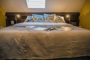 A bed or beds in a room at B&B Pont