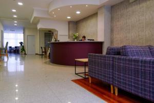 The lobby or reception area at Hotel Vigo Plaza