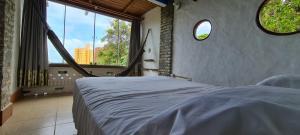 A bed or beds in a room at Pousada Bodega da Terra