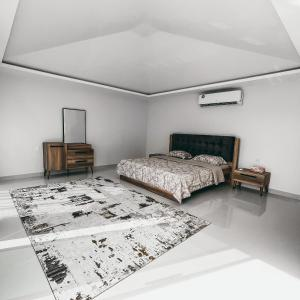 A bed or beds in a room at Seven Elements Resort