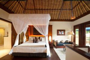 A bed or beds in a room at Pool Villa Club Lombok