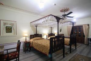 A bed or beds in a room at Jagat Palace