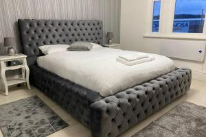 A bed or beds in a room at The Chesterfield - New York Apartment