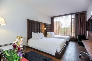 A bed or beds in a room at NH Collection Bogota Andino Royal