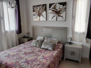 Cama o camas de una habitación en Villa Sunset Faro Deluxe