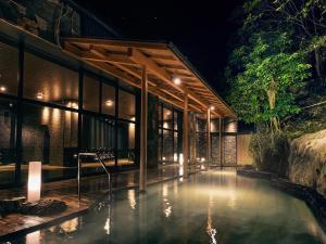 The swimming pool at or near Yukai Resort Shirahama Gyoen