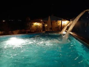 Πισίνα στο ή κοντά στο Hotel Flesvos