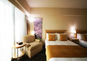 A bed or beds in a room at Chiayi Maison de Chine Hotel