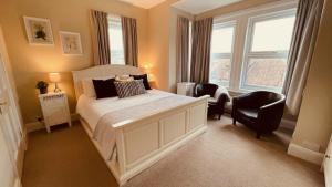Кровать или кровати в номере Arbour House B&B