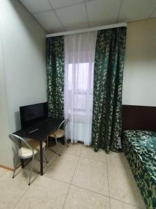 Телевизор и/или развлекательный центр в Мини-отель «5 сезонов»