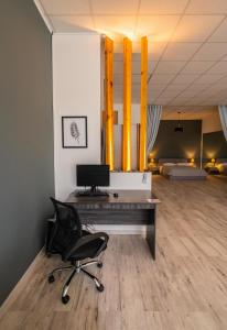 A television and/or entertainment centre at Cinema Zeus Studios - Spata - ATH Airport