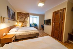 Posteľ alebo postele v izbe v ubytovaní Gościniec Król Sielaw
