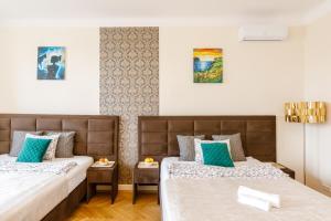 Un ou plusieurs lits dans un hébergement de l'établissement OK Apartments Old Town